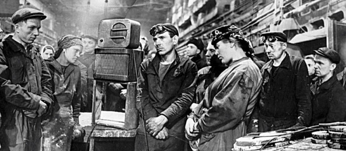 Dynamo engineering workers in Moscow listen to a radio broadcast telling the news of Stalin's death, 1953